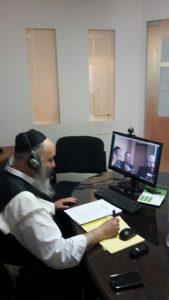 Rabbi Carmel with Antwerp counselors-in-training via skype