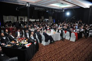 Guests listening to one of the evening's speakers