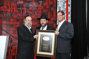 R' Shmuli Margulies and R' Natan Rosentaler presenting Rabbi Yaakov Gutterman with Certificate of Honor